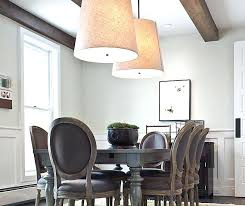 restoration hardware two tier round shade pendant beautiful dining room features exposed wood beams and pair