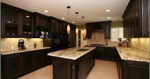 cherry wood kitchen cabinets with black granite homey