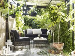 outdoor patio furniture ikea a small terrace furnished coffee table two seat sofa and an rug