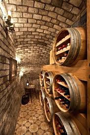 wine room decor wine barrel chandelier wine cellar with brick ceiling brick wall candle sconces double wine room