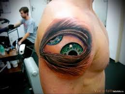 татуировка глаз с двумя зрачками мужская татуировка на плече