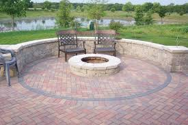 stacked curvy brick stone bench and fire pit with black metal small patio seating ideas patio