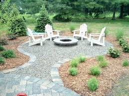 simple patio outdoor fire pit ideas with seat wall and oasis landscapes along backyard throughout design