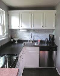 White Kitchen Cabinets With Black Countertops Magnificent Lovely Small Kitchen With Black Laminate Countertops And Marble