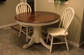 simple dining room design with white painted round extending pedestal kitchen table 2 windsor side