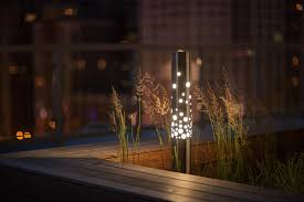 rooftop lighting. light column bollard shown in stainless steel with satin finish 360 degree bubbles shield at one prudential plaza rooftop deck chicago illinois lighting e