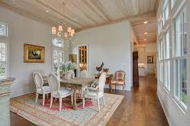 french country house dining room shabby-chic style with light wood ceiling  beach armchairs and accent chairs