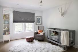 gray boy nursery with white sheepskin rug