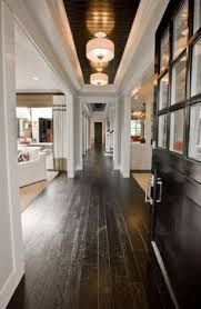 contemporary entryway with flush light hardwood floors islander flooring 3 5 8 solid bamboo flooring in ebony
