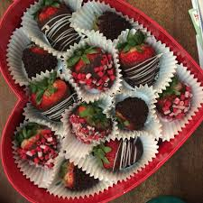 chocolate covered strawberries in a heartshaped box the berries