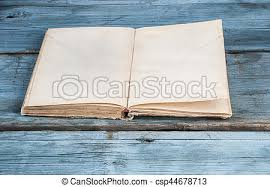 open blank pages of old book on wood background csp44678713
