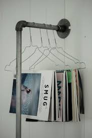 Unique Magazine Rack With Old Pipe And Hangers