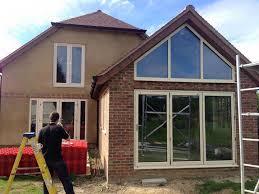 raked window and aluminium bifold doors