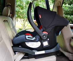 phil and teds alpha is shown above installed in the center seat in a vehicle that
