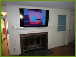 appealing how to mount tv over fireplace and hide wires on brick