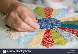 Woman's Hand Sewing Patchwork Quilt Stock Photo, Royalty Free ... & Woman's Hand Sewing Patchwork Quilt Adamdwight.com