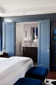 en suite bathroom in french. en suite bathroom with blue double doors in french a