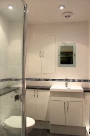 black and white bathroom furniture. White Gloss Fitted Bathroom Units With Black Worktop And Furniture W