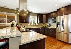 dark kitchen cabinets with light countertops how can