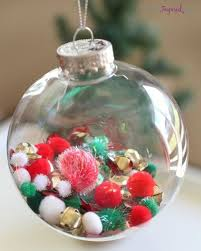 colorful pompoms to fill a glass ornament