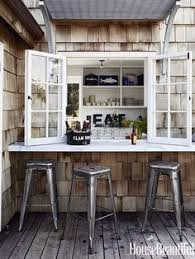 kitchen window opens to outside bar outdoor dining outdoor rooms outdoor kitchens