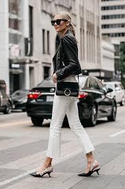 blonde woman wearing club monaco black leather jacket everlane white crop jeans chloe faye black handbag