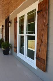 wooden shutters. Beautiful Wooden Grey Exterior With Wooden Shutters And Brick Bottom Intended Wooden Shutters N