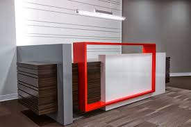 custom designed reception desk with a welded metal accent painted in bright red