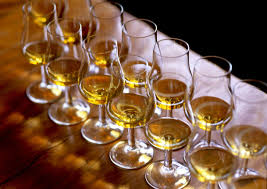 pouring the whisky when tasting
