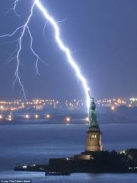 bolt from the blue jay fine captured this incredible image as lightning strikes the statue of liberty in new york harbour