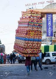 pile of mattresses. Man Carries Pile Of Foam Mattresses In Merkato Market Addis Ababa Ethiopia Stock Photo - 29887484 M