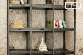 office shelf. Typical Of Early 20th Century Sorting Offices, These Shelves Have A Rust-black Distressed Office Shelf
