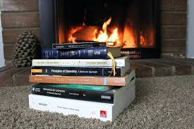 inspirational twin city fireplace and a stack of history books to get you ready for fun