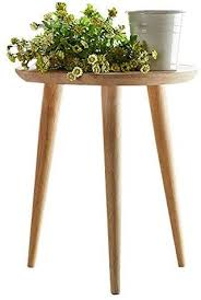 This pair of solid wood nesting tables features circular, acacia veneer tabletops with quartered paneling that highlights the striking variations in the natural wood grain. Amazon Com Woodshine Side Table Small Round Solid Wood Sofa Table End Tables Accent Nesting Coffee Table Natural H 18 11inch Kitchen Dining
