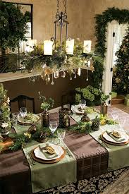 greenery and gold ornaments for a candle chandelier