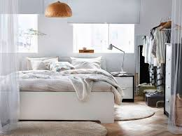 ikea bedroom lighting. guest bedroom inspiration a light with big white bed completed beige bedtextiles and offwhite rugs thick high pile ikea lighting