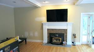 mounting a tv over a fireplace without studs mounting above fireplace above fireplace too high how