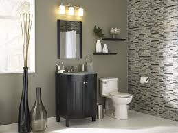 home depot bathroom lighting wall sconces with small mirror and undermount bathroom sink also two glass vases in mosaic bathroom wall tiles