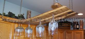 hardwood hanging wine glass rack over brown light kitchen mounted wall cabinet