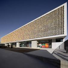 Barcelona's Beautiful Martinet School Boasts a Sun-Shielding Ceramic Facade  Martinet primary school by Mestura