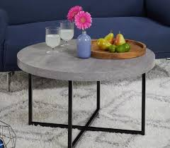 round coffee table with a gray laminate top and a black metal base