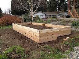 raised wooden garden beds on a slope designs