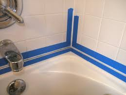 press it down tightly so that the new bathtub caulk doesn t migrate under the tape especially at the tile joints if you have them in your shower wall