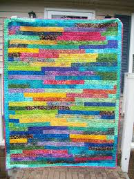 Sew Cook and Travel: Rainbow Batik Strip Quilt Finish & Rainbow Batik Strip Quilt Finish Adamdwight.com