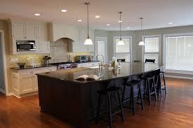 cream colored kitchen cabinets with dark island