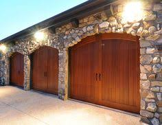 Clopay Canyon Ridge Collection faux wood carriage house garage doors