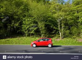 car driving down road. Perfect Down Red Car Driving Down Country Road Through A Forest  Stock Image For Car Driving Down Road D