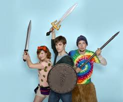 the lightning thief brings the book to life on stage at purdue the three main characters from the lightning thief stand their weapons