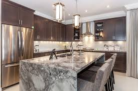 contemporary kitchen with marble waterfall countertop island