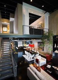 View in gallery Industrial loft with a mezzanine level that features a  guest bedroom